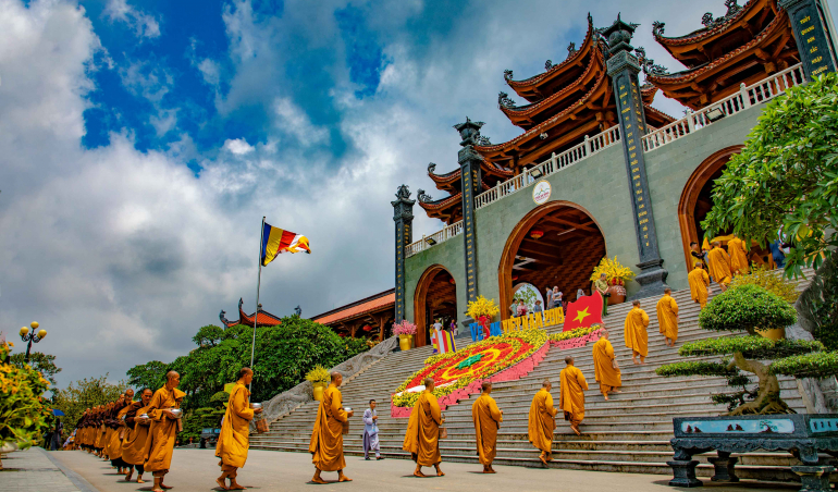 The Sangha going on alms round with their bowls in hand at the pagoda